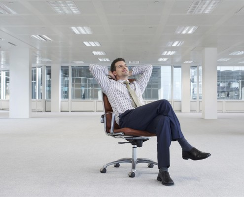 rsz_1relaxing-businessman-on-chair-in-new-office-33895512
